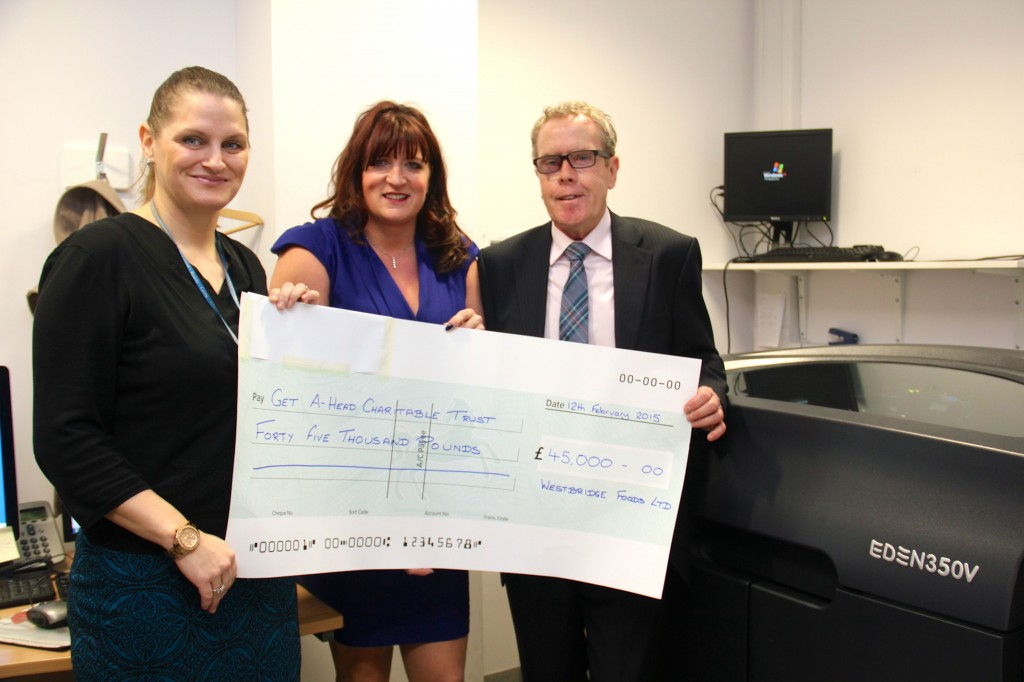 Peter  McNeil presents cheque to Louise Newton of Get A-Head