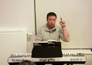 Musical Director putting the cast through their paces