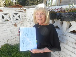 Carole with her recipe book